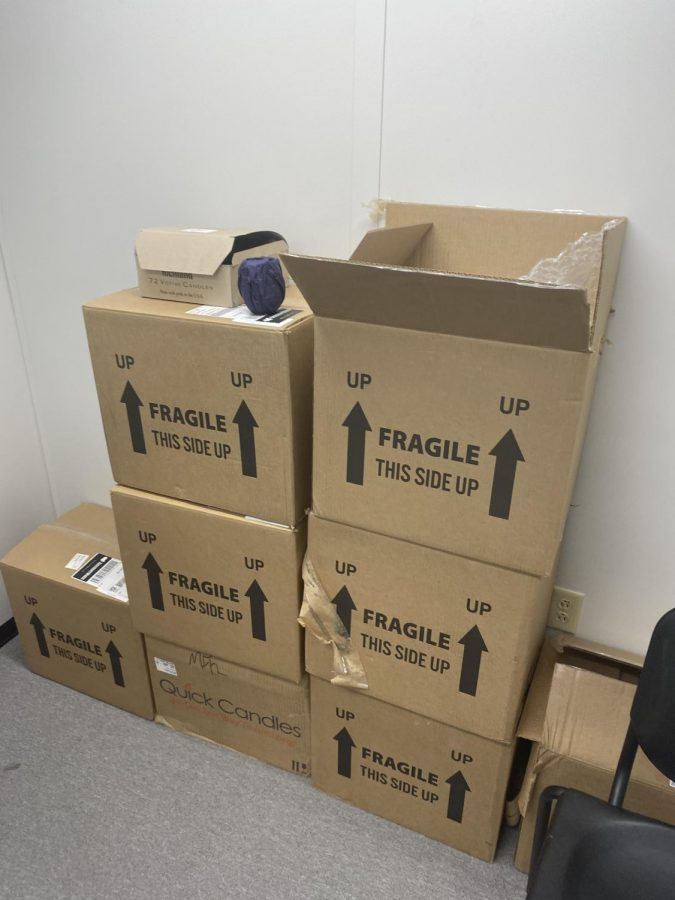 Boxes of decorations from canceled Prom 2020 sit in the music room.
