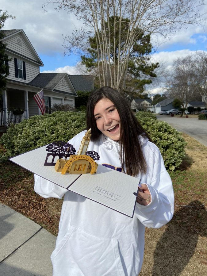 Senior Cailin Proctor holds her acceptance letter to LSU.
